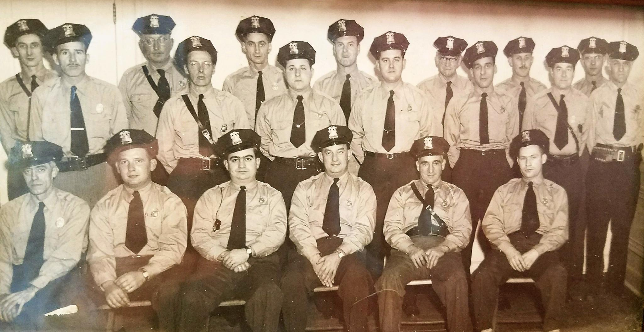 Photo provided by Westfield Police Department Officer Barry Meleen. Pictured is circa 1960s photo of the Westfield policemen, both regular and auxiliary. Only one is identified, that of Robert Peterson (back row, right end with ammunition belt), Meleen's grandfather, who was police chief for many years until his retirement in 1968.
