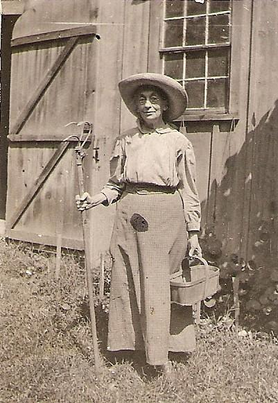 Miss Jennie Macomber circa 1927, as she often appeared when doing her beloved gardening.