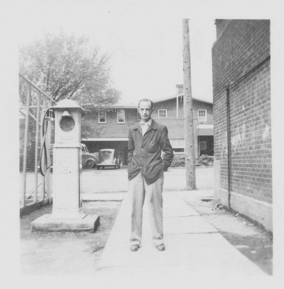 Mr. Blackburn behind the Jr. High Wing of old school (on right), with Vine City Dairy Bar in background. Photo submitted by a 1953, sixth-grade student of Mr. Blackburn.